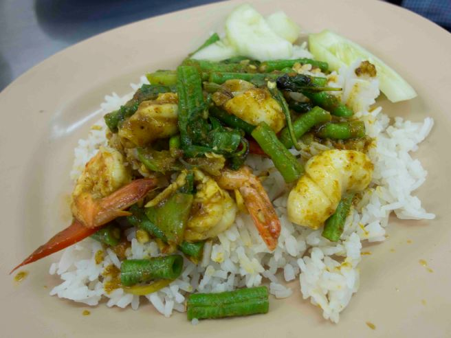 Prawns and squid stir fried with long beans in chilli paste over rice